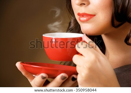 Portrait of pretty woman with cup of coffee, close up - stock photo