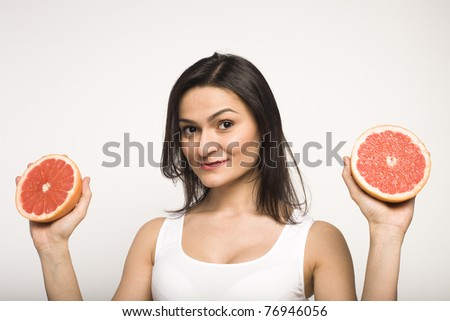portrait of pretty woman with grapefruit
