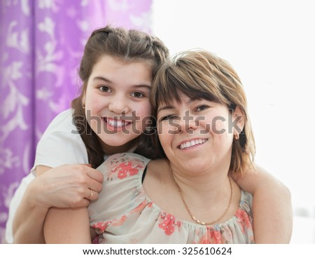 Portrait of   pretty woman with her  teenager daughter