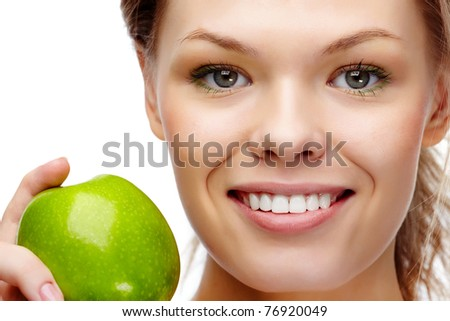 Portrait of pretty woman with smile holding green apple - stock photo