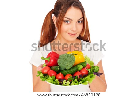 portrait of pretty woman with vegetables. isolated on white