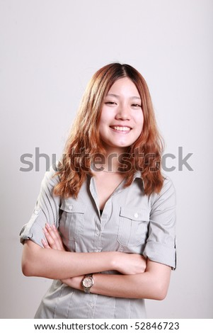 portrait of pretty young Asian girl smiling