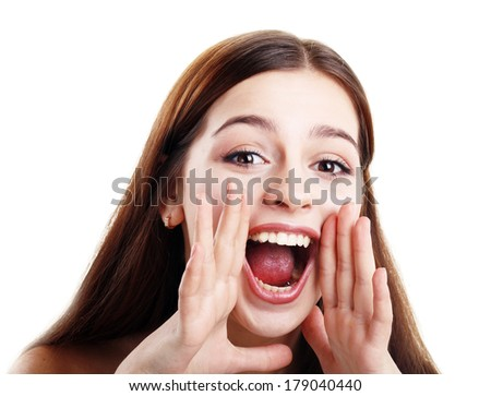 portrait of pretty young beautiful teen girl loud screaming or calling out to someone, isolated over white background  - stock photo