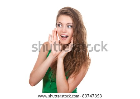 portrait of pretty young beautiful woman whispering or calling out to someone, talking gossip, isolated over white background