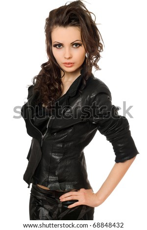 Portrait of pretty young brunette in black clothes. Isolated on white - stock photo