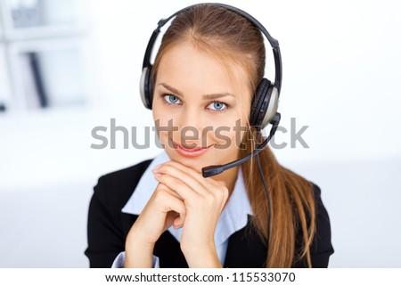 Portrait of pretty young female operator - stock photo
