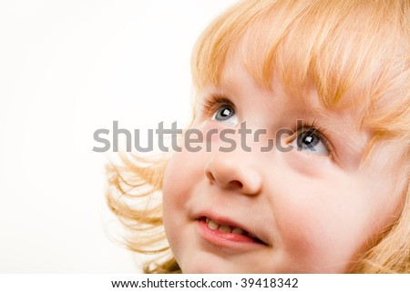 Portrait of pretty young girl looking up - stock photo