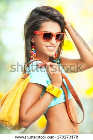 Portrait of pretty young girl with yellow handbag - stock photo