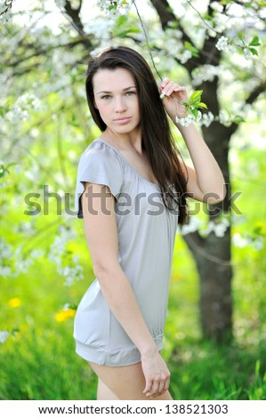 Portrait of pretty young lady in a park - Outdoor