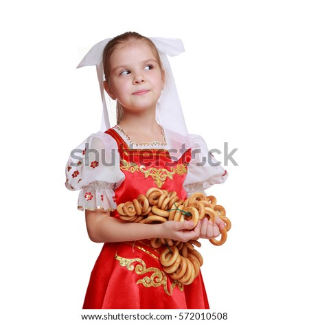 Portrait of pretty young russian girl wearing traditional costume and holding round cracknel/Lovely russian young girl with traditional russian food isolated over white background