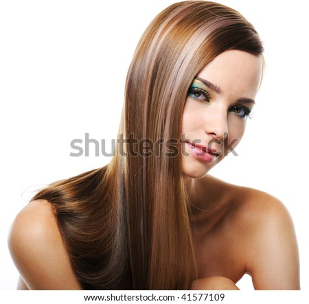 Portrait of pretty young smiling woman with straight long hair - stock photo