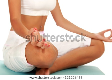 Portrait of pretty young woman doing exercise on mat , isolated on white background