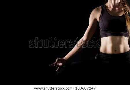 Portrait of pretty young woman doing yoga exercise.