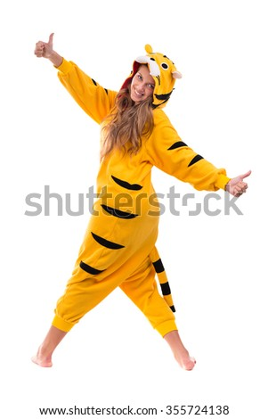 Portrait of pretty young woman in the tiger costume. Isolated on white background in full length.
