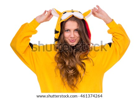 portrait of pretty young woman in the tiger costume isolated on white with copyspace studio shot
