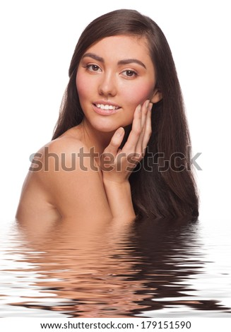 Portrait of pretty young woman with beautiful healthy skin and long brown hair in water. Isolated on white background - stock photo