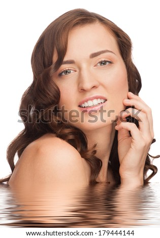 Portrait of pretty young woman with beautiful healthy skin and long brown hair in water. Isolated on white background