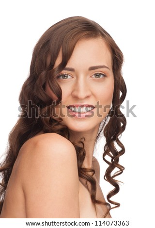 Portrait of pretty young woman with beautiful healthy skin and long curly hair. Isolated on white background
