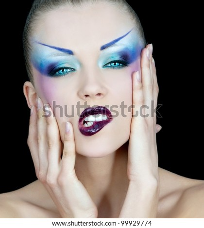 Portrait of pretty young woman with  bright makeup - stock photo