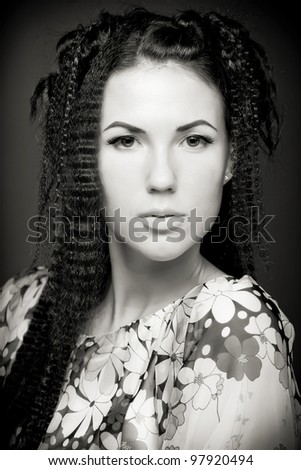 Portrait of pretty young woman with curly hair. Art sepia photo - stock photo