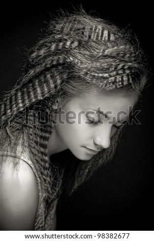 Portrait of pretty young woman with curly hair. Sepia tone.