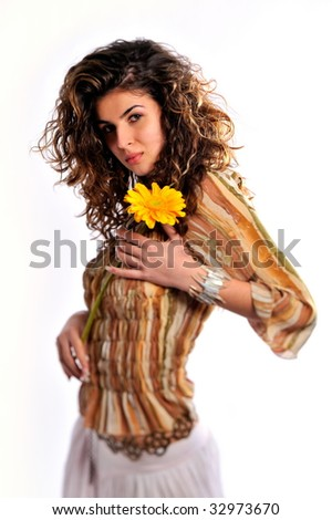 portrait of pretty young woman with yellow flower