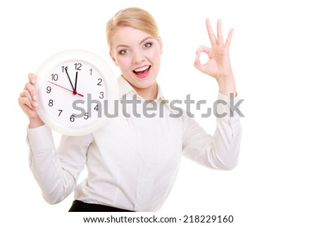 Portrait of professional businesswoman holding clock. Elegant blond girl showing ok okay success hand sign gesture isolated on white. Time for woman in business. Studio shot. - stock photo