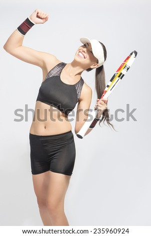 Portrait of Professional Caucasian Tennis Player Excited With Racket showing emotional Exclamation.Vertical Image - stock photo