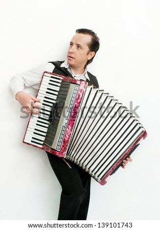 Portrait of professional musician with accordion