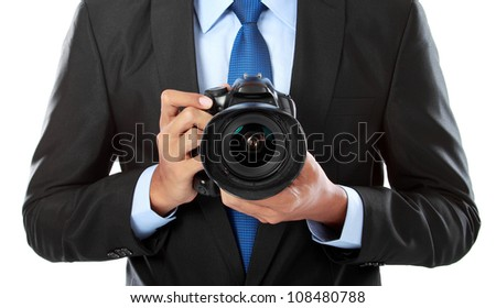 portrait of professional photographer holding a camera - stock photo