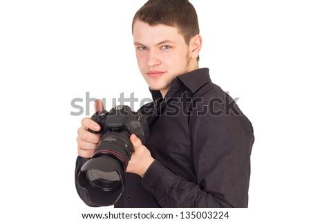 Portrait of professional photographer holding camera and smiling isolated on white background - stock photo