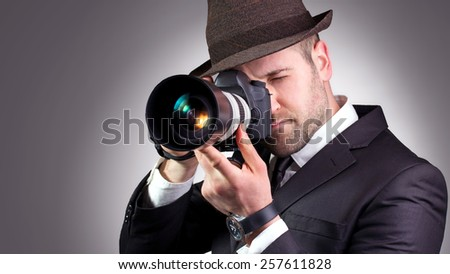 Portrait of professional photographer in action.  - stock photo
