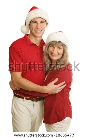 Portrait of proud single mother and handsome young adult son at Christmas time.  Isolated on white.