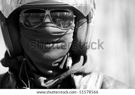 Portrait of racer in helmet on sunglasses ( black white) - stock photo