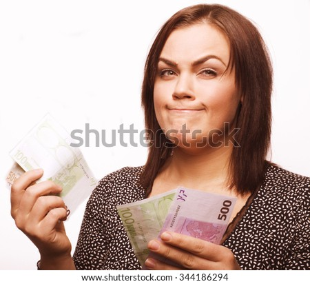 portrait of real fat young woman with money isolated, euro dollar concept