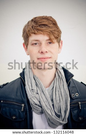 Portrait of real young man on simple background - stock photo