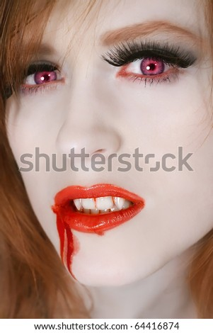 Portrait of red hair woman vampire - stock photo