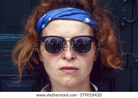 portrait of red hair woman with sunglasses