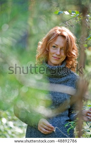 Portrait of red-haired adult women in nature