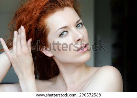 Portrait of red-haired girl - stock photo