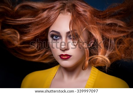 Portrait of red-haired girl with beautiful makeup