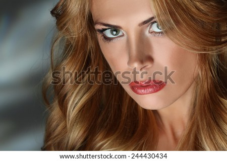 Portrait of red-haired girl with long braids. beautiful makeup. sexy lips. sensual look