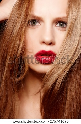 Portrait of red haired woman with red lips