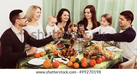 Portrait of relatives celebrating family event at  table