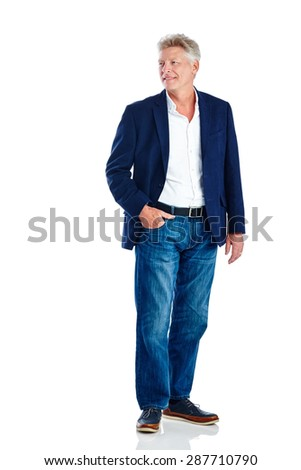 Portrait of relaxed mature man looking away at copyspace while standing on white background