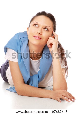 Portrait of relaxed young lady, looking up - stock photo