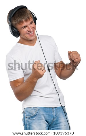 Portrait of relaxed young man listening to music on headphone against isolated on white background