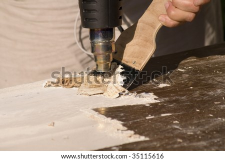 Paint scraper stock images royalty free images vectors for Heat gun to remove paint