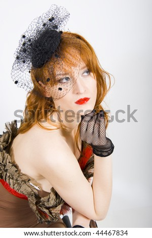 Portrait of retro seductive woman in vintage veil with red lips and smoky eyes. gray background