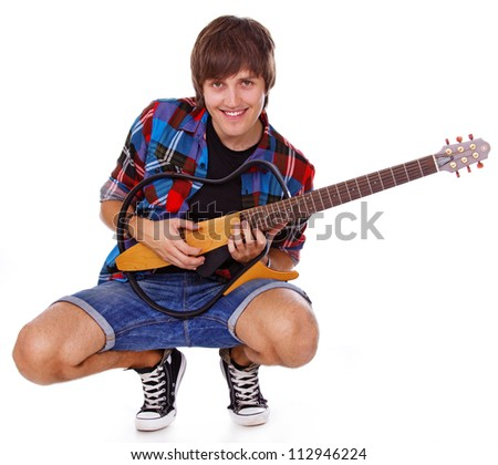 Portrait of rock artist posing in studio with guitar
